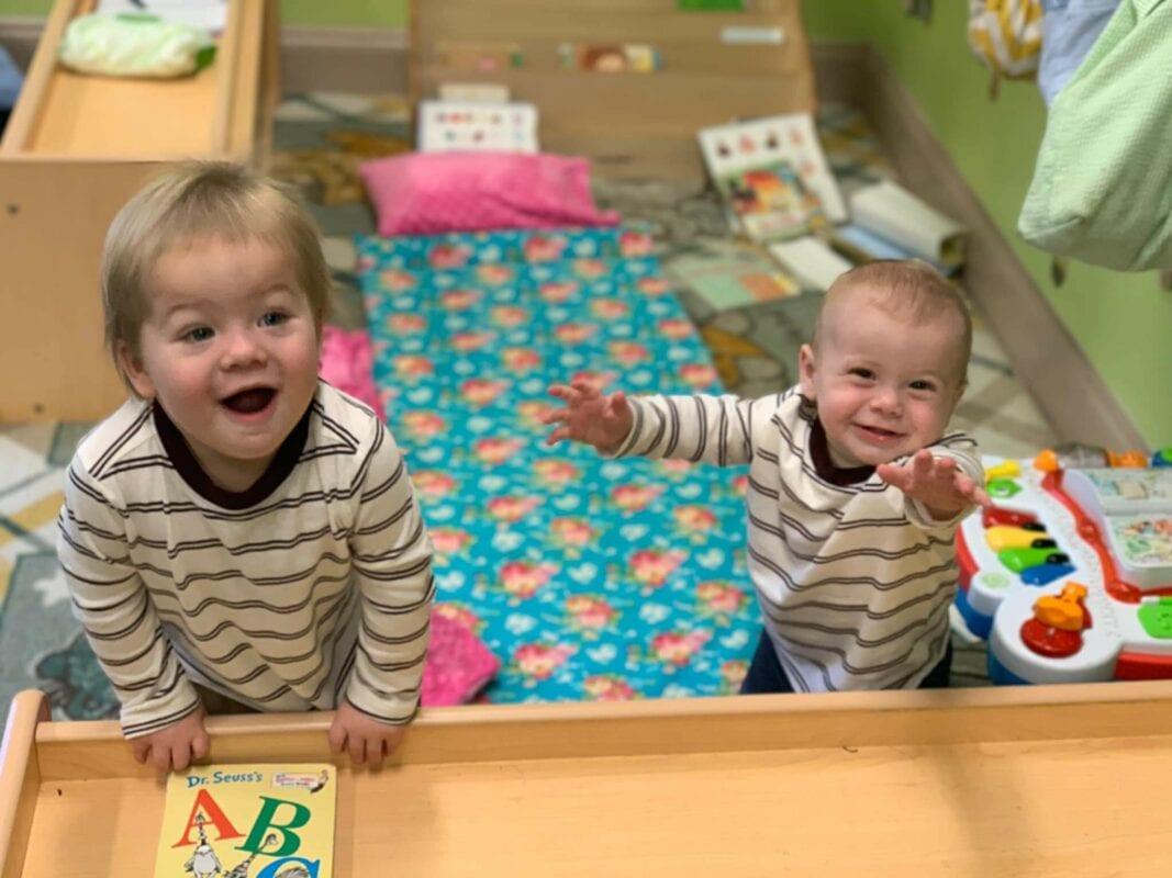 Blonde toddler boys smiling