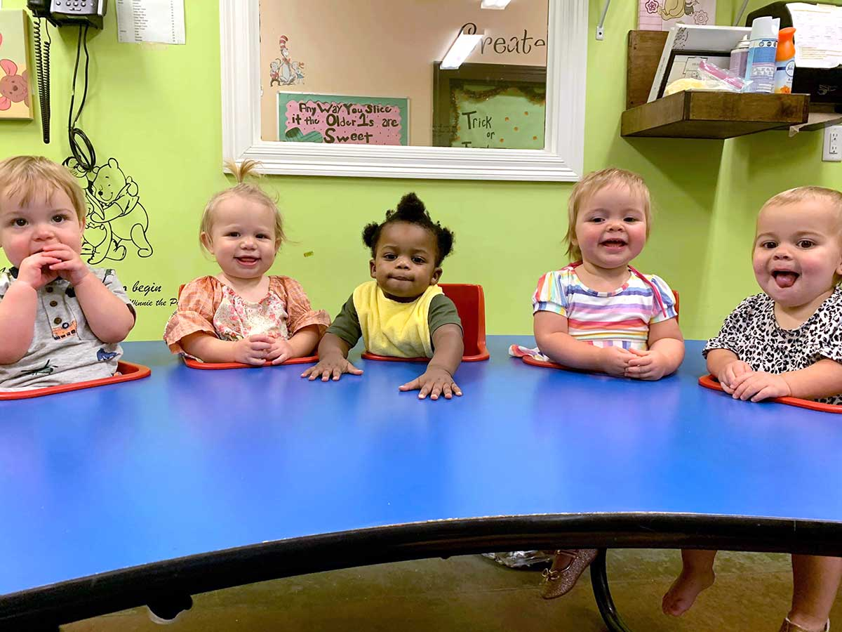 5 Babies Smiling Sitting at Snack Table